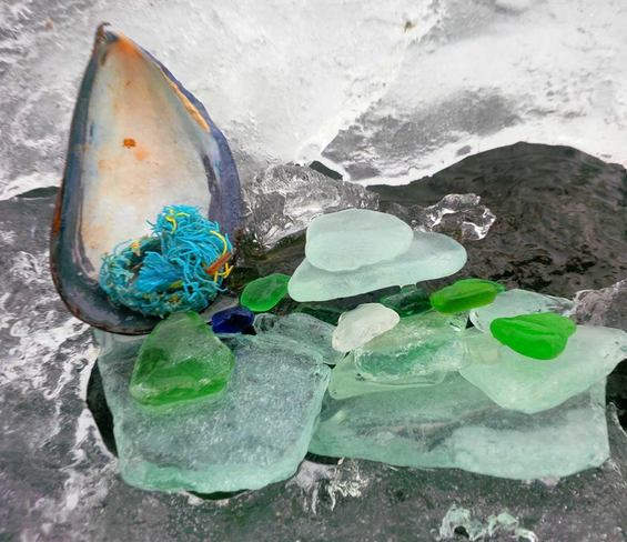 seaglass among the melting ice Canning, Nova Scotia Canada