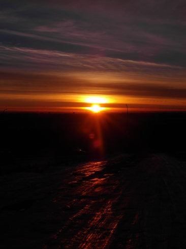Little sun on ice.Sunrise from nose hill Calgary, Alberta Canada