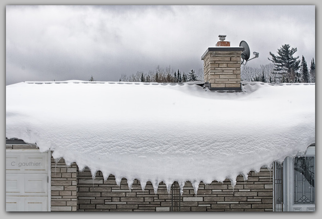 Scalloped edging of roof snow. Magnetawan, Ontario Canada