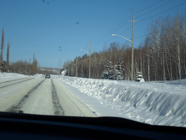 Snow along the side of Pearson Dr.E.L. Elliot Lake, Ontario Canada