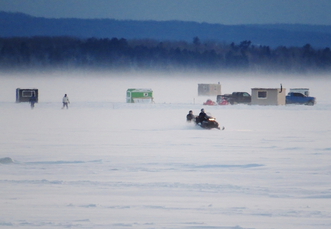 Ice-fishing & snowmobiling the order of the day! North Bay, Ontario Canada