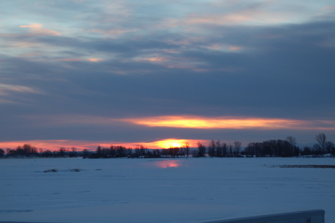 Winter sunrise on the St. Lawrence river Summerstown Station, Ontario Canada
