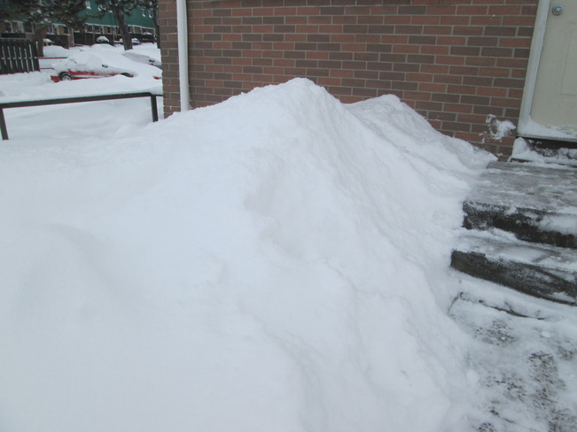 snow pile after the storm Belleville, Ontario Canada