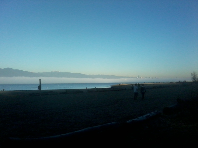 Fog rolling in over the water at Spanish Banks, Vancouver Vancouver, British Columbia Canada