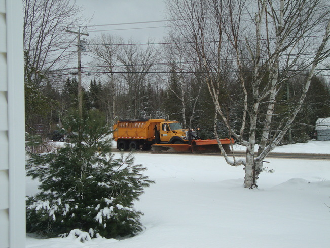 Plow keeping Snow and Rain off the Highway Richibucto Road, New Brunswick Canada