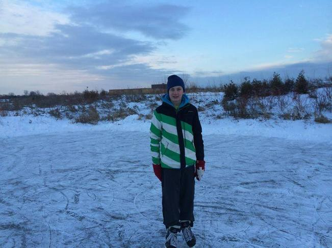 Colin Getting Ready To Skate At The Pond Near His House Bowmanville, Ontario Canada