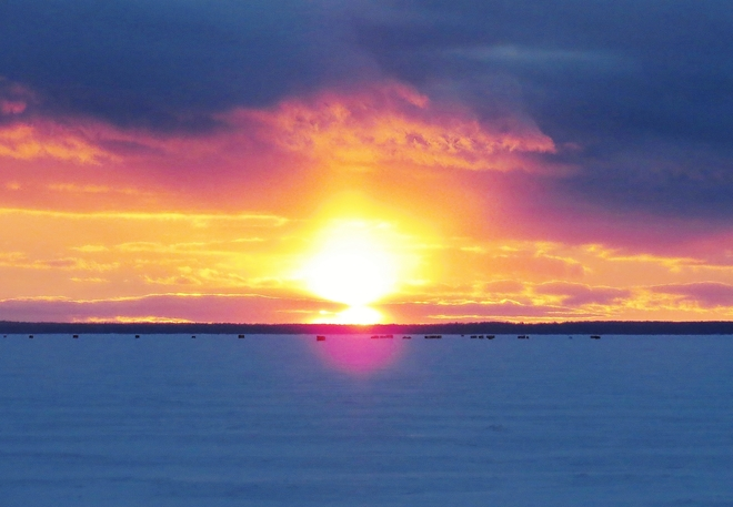 Nice sunset for those in their ice-fishing huts. North Bay, Ontario Canada