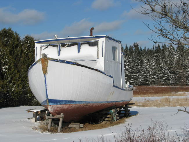 Lobster boat on land Maces Bay, New Brunswick Canada
