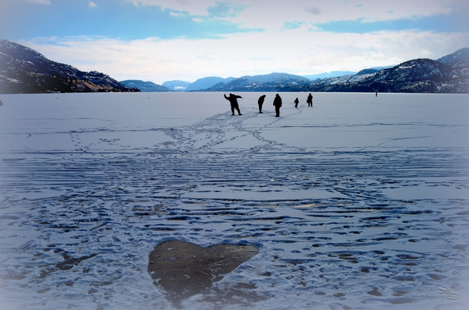 Some people Hart the frozen lake Penticton, British Columbia Canada