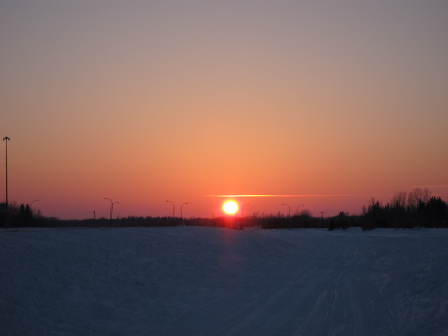 Sunset after a fun filled day of snowmobiling throughout Manitoba including the Teulon, Manitoba Canada