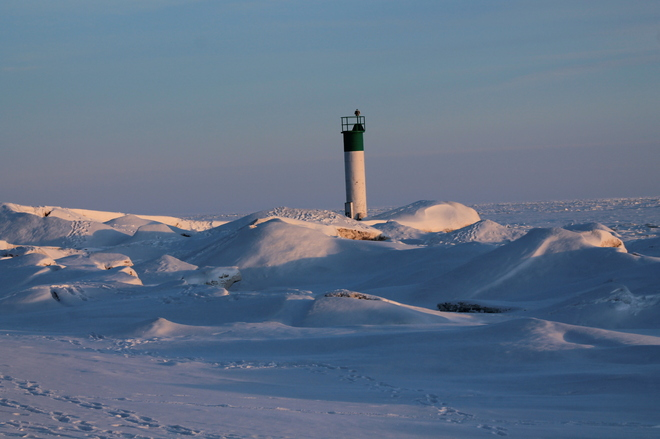 Lighthouse under snow Port Bruce, Ontario Canada