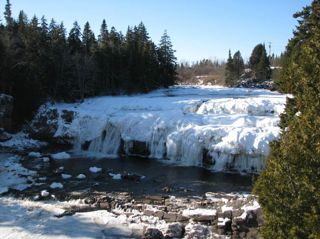 snow covered falls Lepreau, New Brunswick Canada