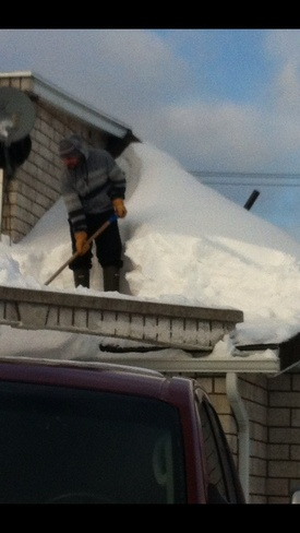 Shovelling my roof Thunder Bay, Ontario Canada