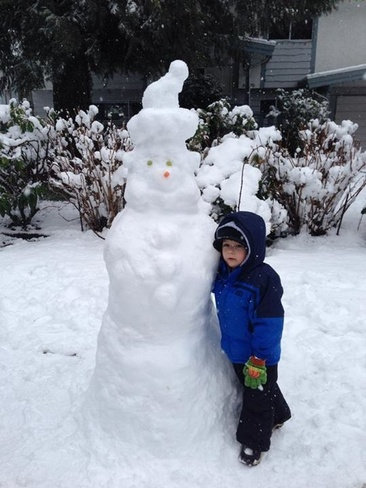 Alex with our snow man Langley, British Columbia Canada