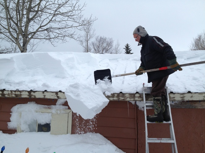 Clearing the roof Lewisporte, Newfoundland and Labrador Canada