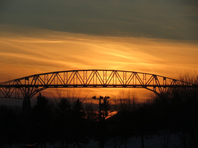 Sunset beyond Seaway International Bridge Cornwall, Ontario Canada