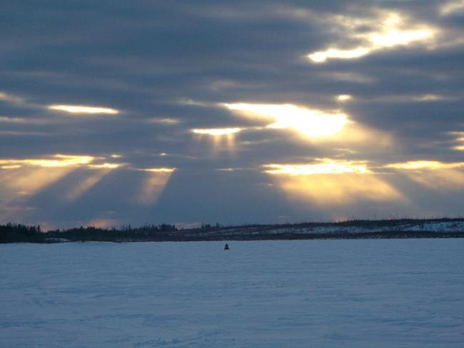 Snowmobiling under the rays. Kasabonika, Ontario Canada