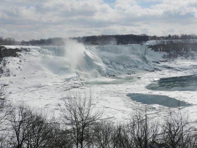 Falls hiding behind snow Niagara Falls, Ontario Canada