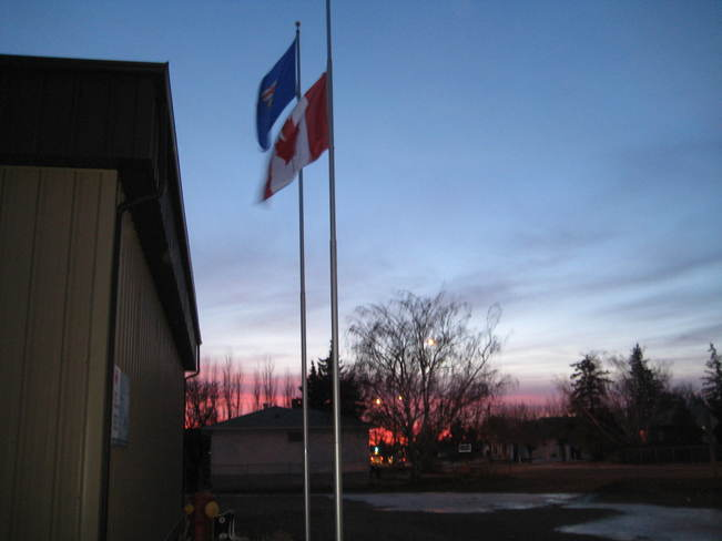 Flag lowered at sunrise Bow Island, Alberta Canada
