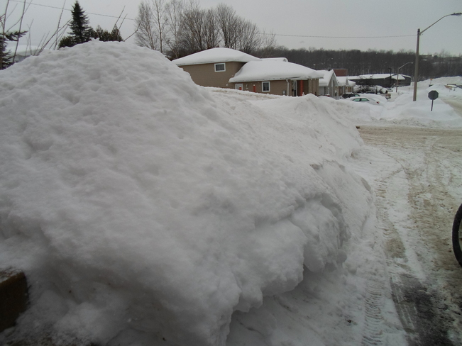 That is a lot of snow beside driveway Elliot Lake, Ontario Canada