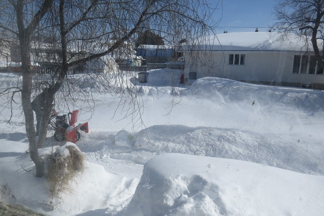 Clearing snow Timmins, Ontario Canada