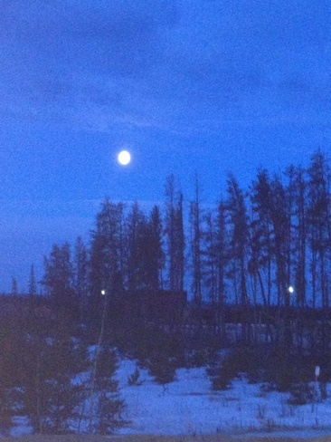 7:05 am. moon shining bright Fort McMurray, Alberta Canada