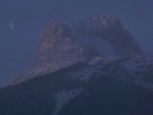Sun Rise And Moon In Background Canmore, Alberta Canada