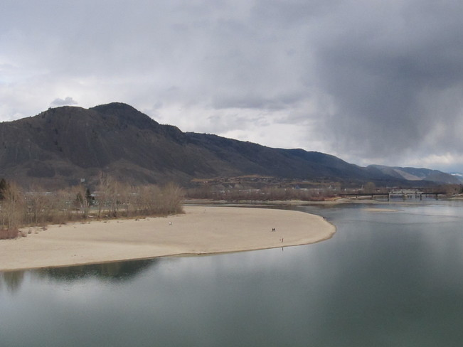 Beautiful rain clouds floating over the river - another view. Kamloops, British Columbia Canada