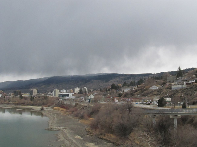 Beautiful rain clouds floating over downtown Kamloops and Riverside Park. Kamloops, British Columbia Canada