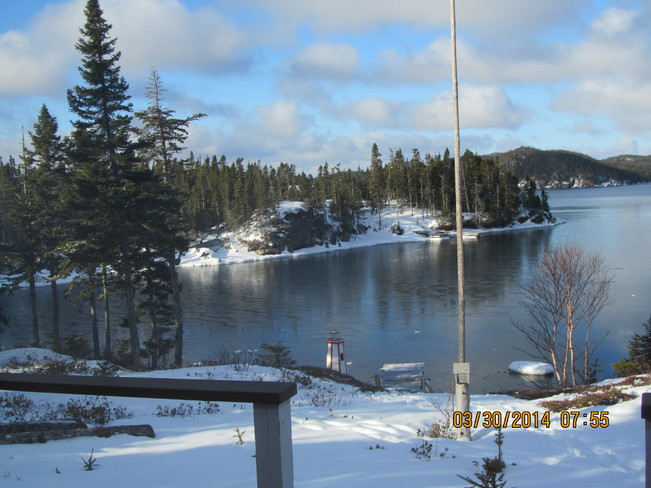 Sunshine coming up in the cove Eastport, Newfoundland and Labrador Canada