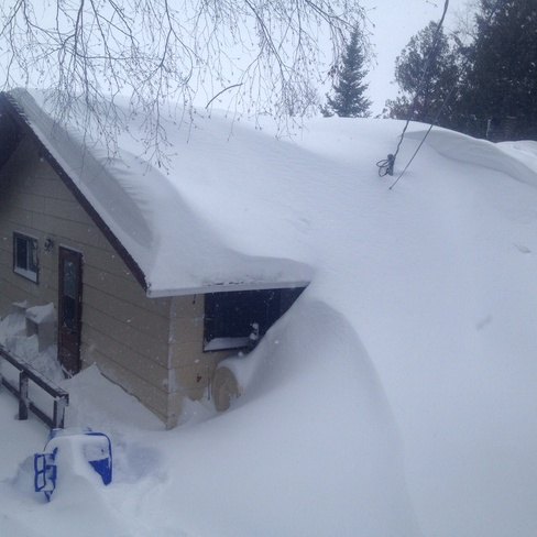 My house burried in snow Dryden, Ontario Canada
