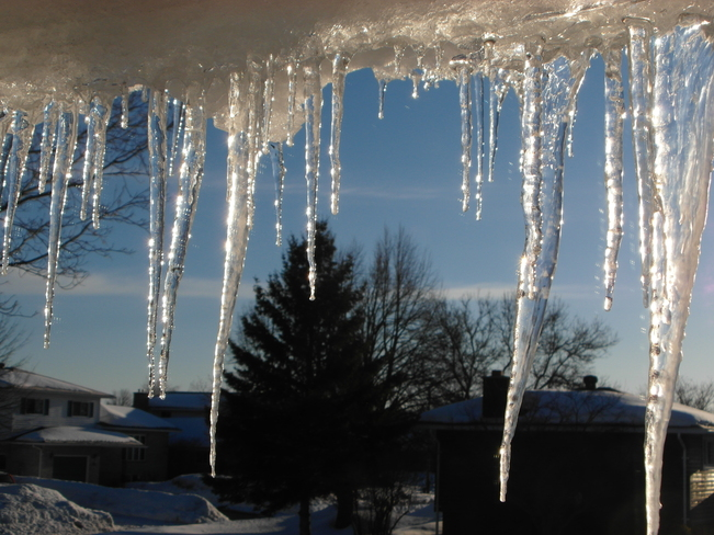 Melting Icicles on Eavestrough Sault Ste. Marie, Ontario Canada