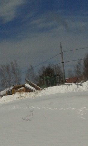 snow plow stuck in snow bank Saint-Louis de Kent, New Brunswick Canada