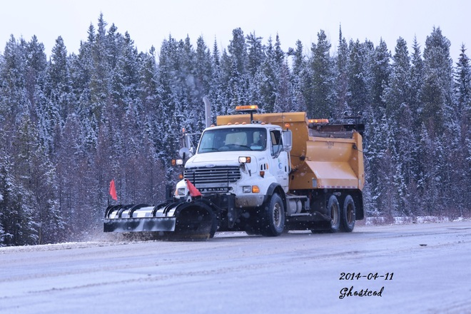 Snow Plow in April, Normal Swan Hills, Alberta Canada