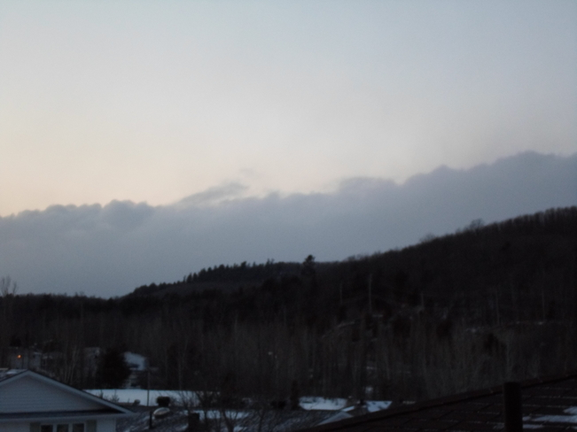 Form fitting cloud over hill top Elliot Lake, Ontario Canada