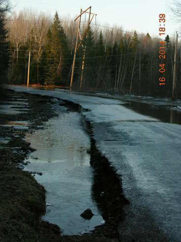 Flooded road and washed away half of it. Salisbury, New Brunswick Canada