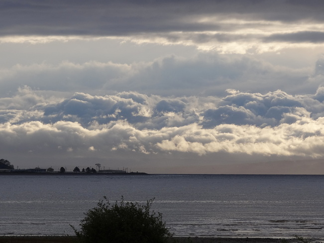 Clouds covering the mainland mountains