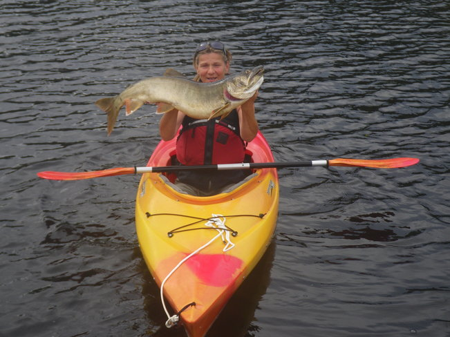 Fishing from kayak Témiscaming, Quebec Canada