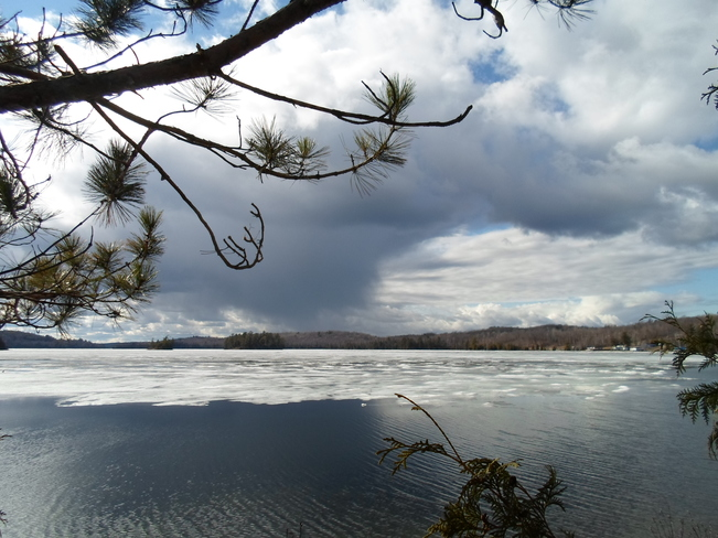 Ice Still on Lake/Dark Cloud moves In Elliot Lake, Ontario Canada