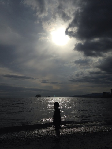silouette of boy and clouds West Vancouver, British Columbia Canada
