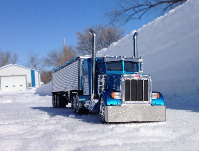 toy truck by snow bank Austin, Manitoba Canada