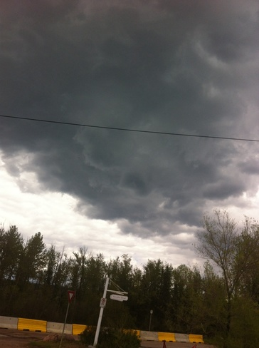 rain clouds over waterways Fort McMurray, Alberta Canada