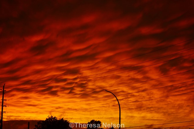 Red orange skies after storm, neat formations Belleville, ON