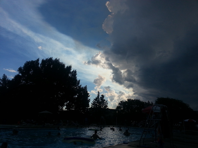 Clouds and wind rolled into the outdoor pool Red Deer, AB