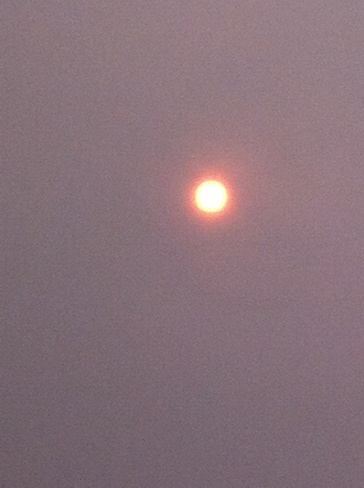 haze over the sun Fort McMurray, Alberta Canada