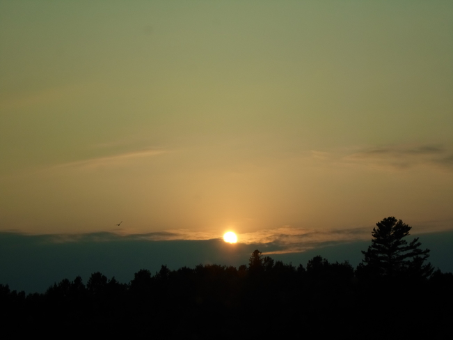 Sun is SETTING over CLOUDS AND TREES E.L. Elliot Lake, Ontario Canada