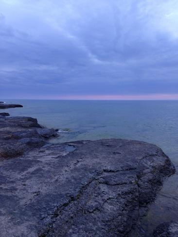 Sun falling into Lake Ontario Prince Edward County, Ontario Canada