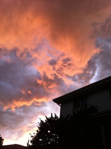 Setting sun vs storm clouds Kingston, Ontario Canada
