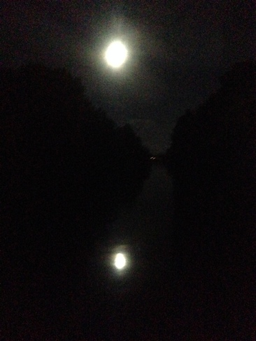 Moon reflecting from Courtenay River Comox Valley, British Columbia Canada