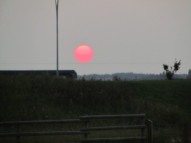 Photos of the sun going down Red Deer, Alberta